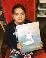 Anastasia Tamm, 8, shows off her favorite painting to date, a pair of swans, in White House, Tenn. on March 5, 2019. Tamm started drawing at three, graduated to painting at six and hopes have a career as a Disney animator someday. (Nicole Young /The Tennessean via AP)