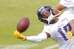 Minnesota Vikings wide receiver Justin Jefferson (18) pulls in a pass during the NFL football team's practice Friday, Aug. 14, 2020, in Eagan, Minn. (AP Photo/Jim Mone)