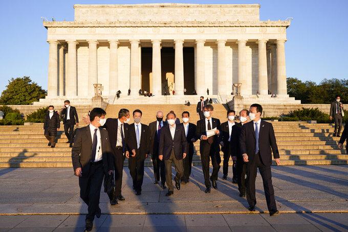 Japanese Prime Minister Yoshihide Suga visits the Lincoln Memorial, Saturday, April 17, 2021, in Washington. (AP Photo/Alex Brandon)