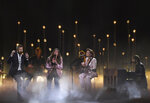 Charles Kelley, left, Hillary Scott, second left and Dave Haywood, right, of Lady Antebellum perform