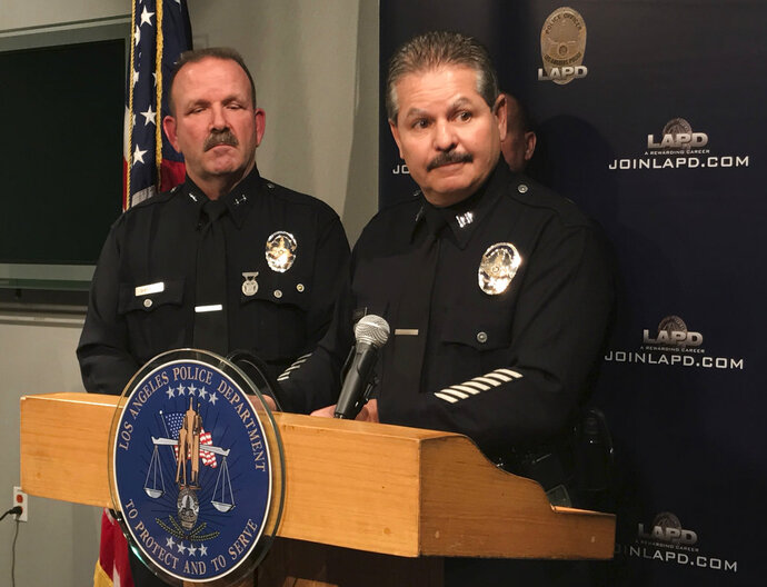 Los Angeles Police Capt. Stephen Carmona, right, speaks at a news conference about cannabis enforcement in Los Angeles Wednesday, Feb. 14, 2018. At left, Los Angeles Police Deputy Chief John Sherman. Los Angeles has issued licenses to nearly 100 cannabis retailers but police estimate there are at least two-to-three times that number operating illegally in the city. Capt. Carmona says Wednesday that police have shut down eight illegal marijuana shops since Jan. 1, 2018. (AP Photo/Mike Balsamo)