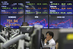 A currency trader watches monitors at the foreign exchange dealing room of the KEB Hana Bank headquarters in Seoul, South Korea, Wednesday, May 20, 2020. Asian shares were mixed Wednesday as market players waffled between hopes for recovery as economies gradually reopen and worries over the havoc wreaked by the pandemic.(AP Photo/Ahn Young-joon)