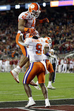 Clemson's Travis Etienne is congratulated by Christian Wilkins (42) after his touchdown during the first half of the NCAA college football playoff championship game against Alabama Monday, Jan. 7, 2019, in Santa Clara, Calif. (AP Photo/David J. Phillip)