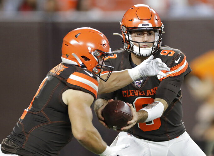 FILE - In this Aug. 29, 2019, file photo, Cleveland Browns quarterback David Blough, right, hands off to A.J Ouellette during the second half of the team's NFL preseason football game against the Detroit Lions in Cleveland.  The Browns have traded Blough to the Lions. Blough completed 11 of 17 passes for 115 yards and threw two interceptions in a 20-16 win in the exhibition finale. Cleveland and Detroit swapped seventh-round draft picks in 2022 in the deal. (AP Photo/Ron Schwane, File)