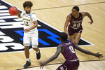 Michigan's Mike Smith (12) gets pressure from Texas Southern's Yahuza Rasas (0) and Michael Weathers (20) during the first half of a First Round game in the NCAA men's college basketball tournament, Saturday, March 20, 2021, at Mackey Arena in West Lafayette, Ind. (AP Photo/Robert Franklin)