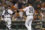 Detroit Tigers catcher Eric Haase, left, fist-bumps starting pitcher Matt Manning after the top of the fifth inning of the team's baseball game against the Toronto Blue Jays, Friday, Aug. 27, 2021, in Detroit. (AP Photo/Jose Juarez)