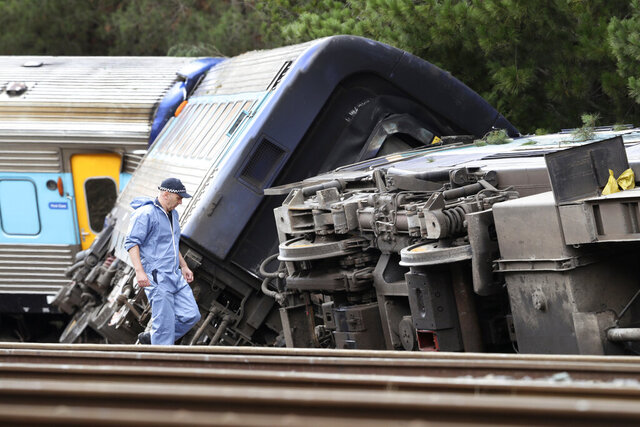 Cars of a passenger train are derailed in Wallan, Victoria, Australia, Friday, Feb. 21, 2020. The train heading from Sydney to Melbourne, carrying 160 passengers and crew, derailed late Thursday, killing two operators. (David Crosling/AAP Image via AP)