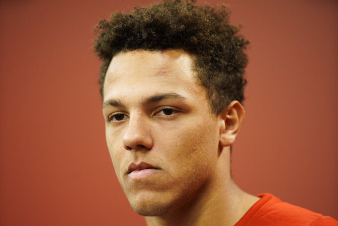 Nebraska quarterback Adrian Martinez takes a question during a news conference in Lincoln, Neb., Monday, Aug. 26, 2019. No. 24 Nebraska is in the preseason Top 25 for the first time since 2014, and a big reason for the positive vibe is Martinez, who last season was the most productive freshman quarterback in the nation. (AP Photo/Nati Harnik)