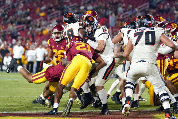 Oregon State's Jack Colletto (12) scores a rushing touchdown during the second half of an NCAA college football game against Southern California Saturday, Sept. 25, 2021, in Los Angeles. (AP Photo/Marcio Jose Sanchez)