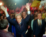 FILE - In this Jan. 13 1996 file photo, presidential candidate Jorge Sampaio waves to supporters upon arriving for his last campaign rally escorted by a smiling Portuguese Prime Minister Antonio Guterres, right, in Lisbon. Sampaio, a former two-term president of Portugal and one of the most prominent political figures of his generation, has died. He was 81. The current Portuguese president, Marcelo Rebelo de Sousa, announced Sampaio's death Friday, Sept 10, 2021. (AP Photo/Armando Franca, File)