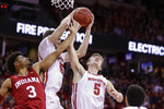 Wisconsin's Nate Reuvers, center, and Tyler Wahl (5) go after a defensive rebound against Indiana's Justin Smith (3) during the first half of an NCAA college basketball game Saturday, Dec. 7, 2019, in Madison, Wis. (AP Photo/Andy Manis)