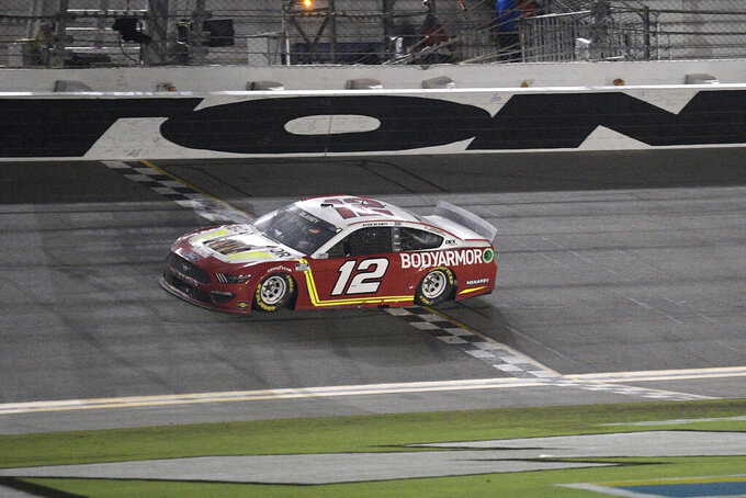 Ryan Blaney (12) crosses the finish line to win a NASCAR Cup Series auto race at Daytona International Speedway, Saturday, Aug. 28, 2021, in Daytona Beach, Fla. (AP Photo/Phelan M. Ebenhack)