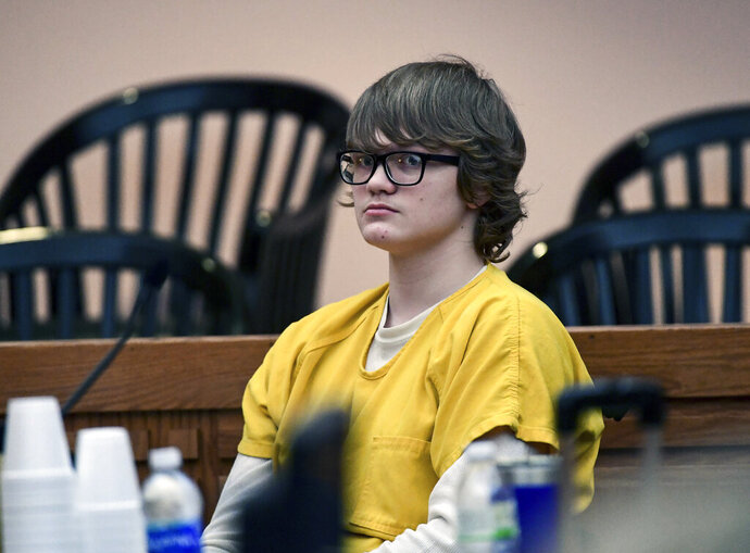 FILE - In this Feb. 16, 2018 file photo, Jesse Osborne waits for a ruling at the Anderson County Courthouse in Anderson, S.C. Prosecutors plan to tell a judge why Osborne, who fired on a South Carolina school playground and killed a first-grader should spend his life in prison. A hearing begins Monday, Nov. 11, 2019 at the Anderson County Courthouse to determine Osborne's sentence. He faces 30 years to life without parole.  (Ken Ruinard/The Independent-Mail via AP, Pool, File)