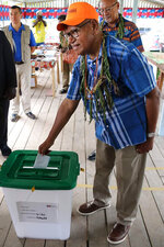 John Momis, president of the Autonomous Region of Bougainville, casts his vote in Buka, Papua New Guinea, Saturday, Nov. 23, 2019, in a historic referendum to decide if they want to become the world's newest nation by gaining independence from Papua New Guinea. (Post Courier via AP)