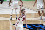 Oklahoma forward Brady Manek celebrates after making a 3-point basket during the second half of a first-round game against Missouri in the NCAA men's college basketball tournament at Lucas Oil Stadium, Saturday, March 20, 2021, in Indianapolis. (AP Photo/Darron Cummings)