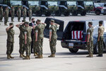 U.S. Marines and sailors salute before removing a casket to be placed aboard a U.S. Air Force C-17 Globemaster III at Marine Corps Air Station Miramar, in Calif., Wednesday, Aug. 12, 2020. The remains of seven Marines and a sailor, who died after a seafaring tank sank off the coast of Southern California last month, were transferred to Dover Air Force Base in Delaware for burial preparations.   (Lance Cpl. Brendan Mullin/U.S. Marine Corps via AP)