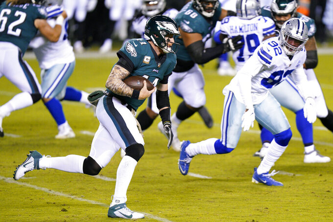 Philadelphia Eagles' Carson Wentz runs during the first half of an NFL football game against the Dallas Cowboys, Sunday, Nov. 1, 2020, in Philadelphia. (AP Photo/Chris Szagola)