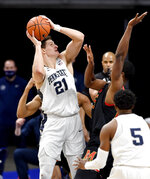 Penn State's John Harrar looks to the basket around Maryland defenders during an NCAA college basketball game Friday, Feb. 5, 2021, in State College, Pa. (Abby Drey/Centre Daily Times via AP)
