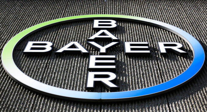 FILE - This Monday, May 23, 2016, file photo, shows the Bayer AG corporate logo displayed on a building of the German drug and chemicals company in Berlin. Three schoolteachers in Washington state who sued chemical company Monsanto over exposure to materials in fluorescent lights have been awarded $185 million. Bayer, which bought Monsanto in 2018, said the company disagreed with the verdict and may appeal. (AP Photo/Markus Schreiber, File)