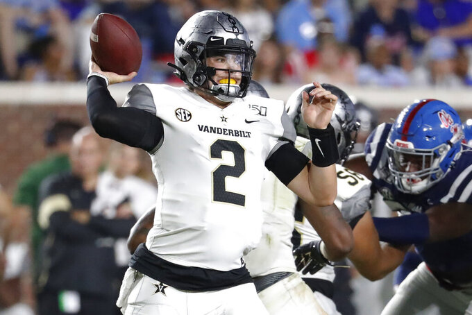 Vanderbilt quarterback Deuce Wallace throws a pass against Mississippi during the second half of an NCAA college football game in Oxford, Miss., Saturday, Oct. 5, 2019. Mississippi won 31-6. (AP Photo/Rogelio V. Solis)