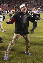 Georgia head coach Kirby Smart celebrates as time expires for a 21-14 victory over Auburn in an NCAA college football game, Saturday, Nov. 16, 2019, in Auburn, Ala. (Curtis Compton/Atlanta Journal-Constitution via AP)