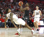 Georgia guard Jordan Harris is called for an offensive foul knocking Texas A&M guard Wendell Mitchell to the hardwood during the first half in a NCAA college basketball game on Saturday, Feb. 1, 2020, in Athens. (Curtis Compton/Atlanta Journal-Constitution via AP)