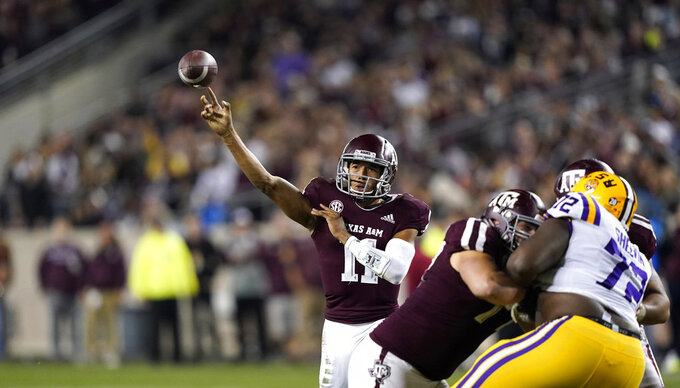 Texas A&M quarterback Kellen Mond (11) throws a pass against LSU during the second half of an NCAA college football game Saturday, Nov. 24, 2018, in College Station, Texas. Texas A&M won 74-72 in seven overtimes. (AP Photo/David J. Phillip)