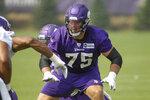 Minnesota Vikings tackle Brian O'Neill (75) blocks during NFL football training camp Friday, July 30, 2021, in Eagan, Minn. (AP Photo/Bruce Kluckhohn)