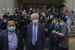 Pro-democracy activists Martin Lee, center, and Albert Ho, left, arrive at a court in Hong Kong Friday, April 16, 2021. Seven of Hong Kong's leading pro-democracy advocates, including Lee and pro-democracy media tycoon Jimmy Lai, are expected to be sentenced Friday for organizing a march during the 2019 anti-government protests that triggered an overwhelming crackdown from Beijing. (AP Photo/Kin Cheung)