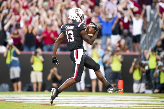 South Carolina wide receiver Shi Smith (13) scores a touchdown during the second half of an NCAA college football game Saturday, Oct. 13, 2018, in Columbia, S.C. Texas A&M defeated South Carolina 26-23. (AP Photo/Sean Rayford)