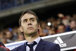 FILE - In this Saturday, Nov. 11, 2017 filer, Spain coach Julen Lopetegui stands by the bench during the international friendly soccer match between Spain and Costa Rica in Malaga, Spain. (AP Photo/Miguel Morenatti, File)