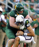 FILE - In this Aug. 31, 2019, file photo, Baylor defensive tackle James Lynch, top, sacks Stephen F. Austin's Trae Self in the first half of an NCAA college football game in Waco, Texas. The Minnesota Vikings selected Lynch in the fourth round of the NFL football draft on Saturday, April 25, 2020. (Rod Aydelotte/Waco Tribune-Herald via AP, File)