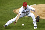 Washington Nationals starting pitcher Erick Fedde fields a grounder by Philadelphia Phillies' Alec Bohm during the fifth inning of a baseball game, Wednesday, Sept. 23, 2020, in Washington. Bohm was out at first. (AP Photo/Nick Wass)