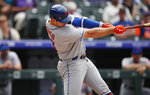 New York Mets' Pete Alonso connects for a solo home run off Colorado Rockies starting pitcher Jeff Hoffman in the sixth inning of a baseball game Wednesday, Sept. 18, 2019, in Denver. (AP Photo/David Zalubowski)