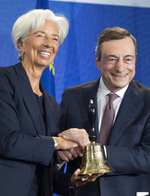 Outgoing European Central Bank President Mario Draghi shakes hands with his designated successor Christine Lagarde, at a ceremony celebrating the change at the head of the ECB in Frankfurt, Germany, Monday, Oct. 28, 2019. Draghi leaves as head of the European Central Bank credited with having rescued the eurozone from disaster with a well-timed phrase and bold action to back up his words. (Boris Roessler/Pool Photo via AP)