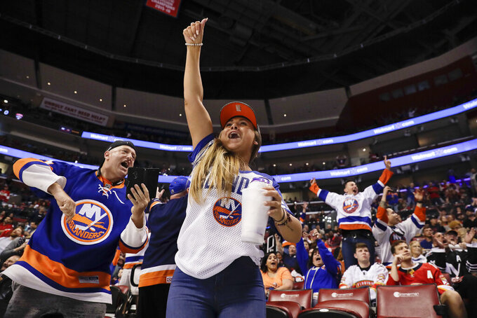 Marti Provenzano, of Rye Brook, NY., celebrates after a shot on goal by Florida Panthers' Aleksander Barkov was saved by New York Islanders goaltender Thomas Greiss during during the first period of an NHL hockey game on Thursday, April 4, 2019, in Sunrise, Fla. (AP Photo/Brynn Anderson)