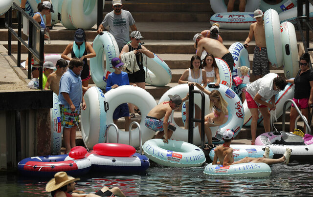 Tubers prepare to float the Comal River despite the recent spike in COVID-19 cases, Thursday, June 25, 2020, in New Braunfels, Texas. Texas Gov. Greg Abbott said Wednesday that the state is facing a