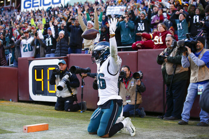 Philadelphia Eagles running back Miles Sanders (26) raises his arms after scoring a touchdown in the second half of an NFL football game against the Washington Redskins, Sunday, Dec. 15, 2019, in Landover, Md. (AP Photo/Alex Brandon)