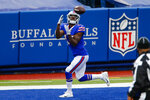 Buffalo Bills wide receiver John Brown (15) catches a touchdown pass thrown by quarterback Josh Allen (17) in the first half of an NFL football game against the Miami Dolphins, Sunday, Jan. 3, 2021, in Orchard Park, N.Y. (AP Photo/John Munson)