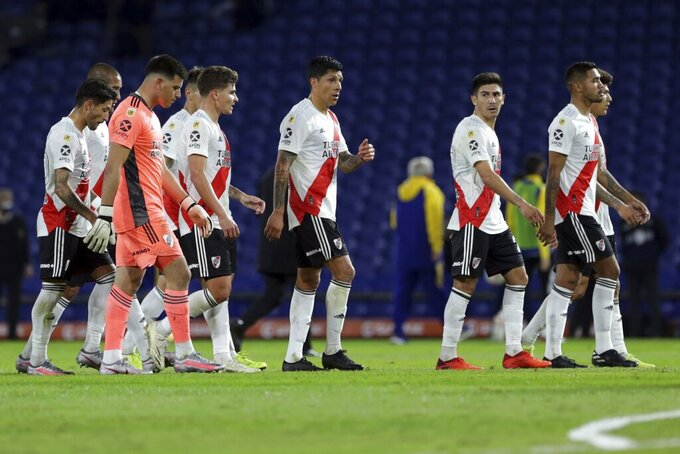 River Plate players walk off the field at the first half of a local league soccer match against Boca Juniors at the Bombonera stadium in Buenos Aires, Argentina, Sunday, May 16, 2021. (AP Photo/Daniel Jayo)