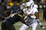 Georgia Southern quarterback Shai Werts carries as Appalachian State linebacker Akeem Davis-Gaither (24) closes in during the first half of an NCAA college football game Thursday, Oct. 31, 2019, in Boone, N.C. (AP Photo/Brian Blanco)