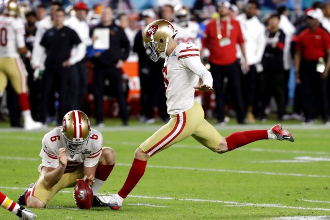 San Francisco 49ers' Robbie Gould, right, kicks a field goal from the hold of Mitch Wishnowsky during the first half of the NFL Super Bowl 54 football game against the Kansas City Chiefs Sunday, Feb. 2, 2020, in Miami Gardens, Fla. (AP Photo/Seth Wenig)