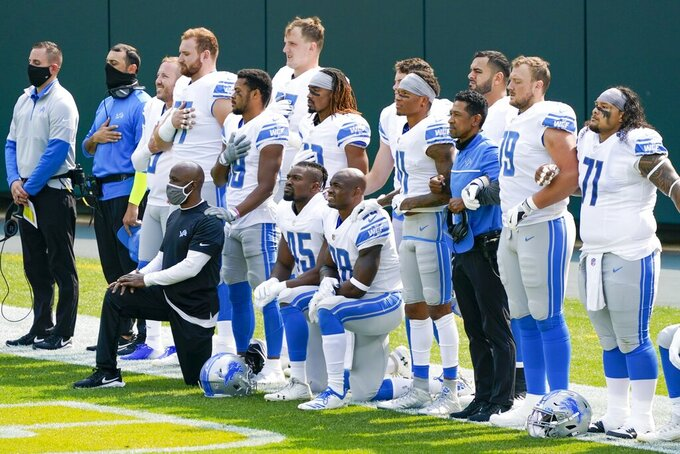 Some Detroit Lions player take a knee during the national anthem before an NFL football game against the Green Bay Packers Sunday, Sept. 20, 2020, in Green Bay, Wis. (AP Photo/Morry Gash)
