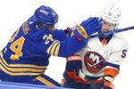 Buffalo Sabres forward Dylan Cozens (24) and New York Islanders forward Casey Cizikas (53) collide during the first period of an NHL hockey game, Monday, May 3, 2021, in Buffalo, N.Y. (AP Photo/Jeffrey T. Barnes)