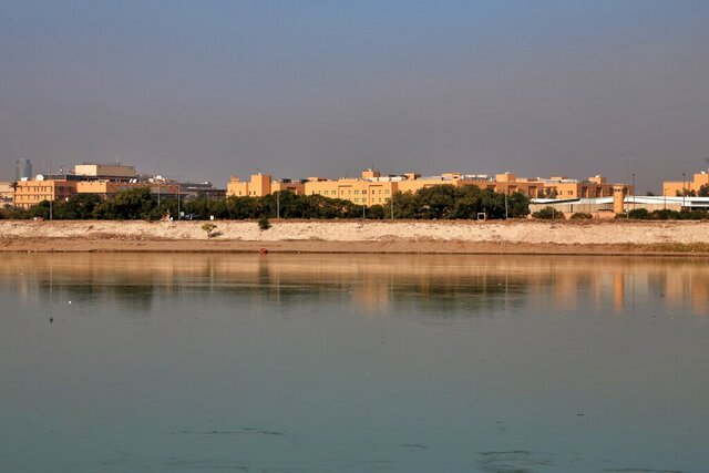 FILE - In this Friday, Jan. 3, 2020, file photo, the U.S. Embassy is seen across the Tigris River in Baghdad, Iraq. Iraq's military says two rockets hit Baghdad's heavily fortified Green Zone, the seat of the government and home to the U.S. Embassy. (AP Photo/Khalid Mohammed, File)