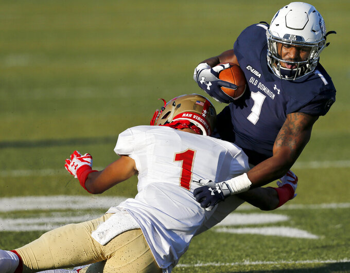 Old Dominion's Kesean Strong, right, is brought down by VMI defender Kris Thornton during an NCAA college football game, Saturday, Nov. 17, 2018, in Norfolk, Va. (Stephen M. Katz/The Virginian-Pilot via AP)