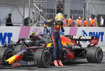 Red Bull driver Max Verstappen of the Netherlands jumps out of his car after winning the Austrian Formula One Grand Prix at the Red Bull Ring racetrack in Spielberg, Austria, Sunday, July 4, 2021. (AP Photo/Darko Bandic)