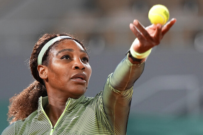United States Serena Williams prepares to serve to Romania's Irina-Camelia Begu during their first round match on day two of the French Open tennis tournament at Roland Garros in Paris, France, Monday, May 31, 2021. (AP Photo/Michel Euler)