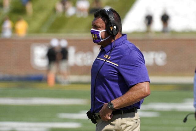 LSU head coach Ed Orgeron watches from the sidelines during the first half of an NCAA college football game against Missouri Saturday, Oct. 10, 2020, in Columbia, Mo. (AP Photo/L.G. Patterson)