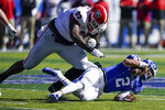 Georgia defensive lineman Jordan Davis (99) tackles Kentucky quarterback Joey Gatewood (2) during the first half of an NCAA college football game, Saturday, Oct. 31, 2020, in Lexington, Ky. (AP Photo/Bryan Woolston)